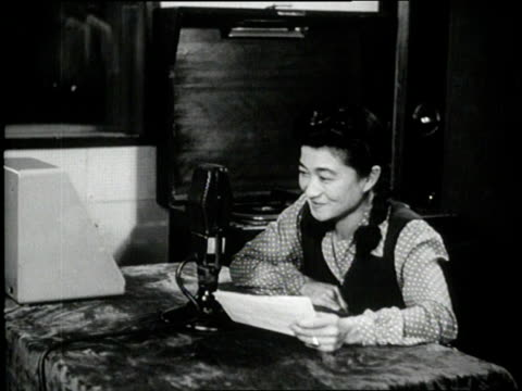 tokyo rose talks into a microphone during her radio broadcast. - radio broadcasting stock videos & royalty-free footage