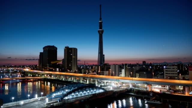 tokyo sky tree landmark of tokyo , time lapse sunrise morning in tokyo , japan - capital cities stock videos & royalty-free footage