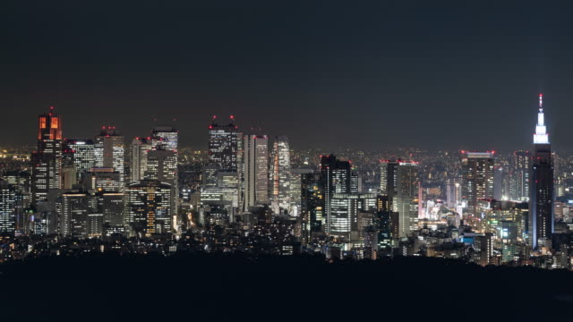 tokyo skyline at night (panning/time lapse) - local government building stock videos & royalty-free footage