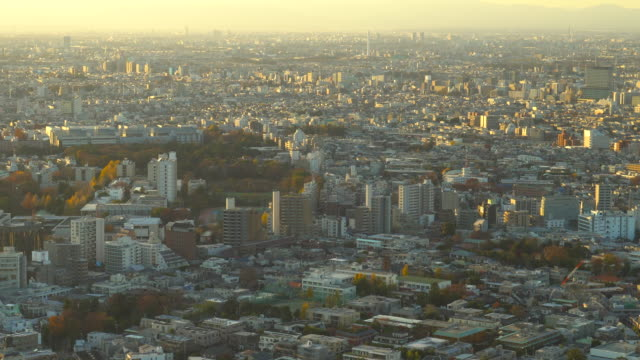 tokyo skyline at sunset | zoom out - plusphoto stock videos & royalty-free footage
