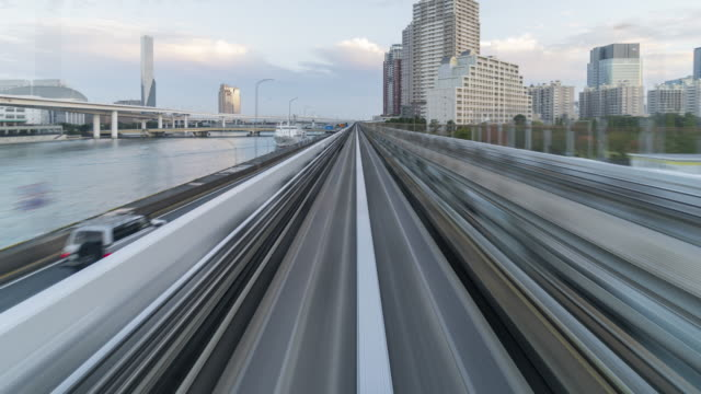 tokyo skyline from automated train - railway track stock videos & royalty-free footage