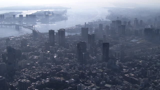 aerial, tokyo skyline in fog, japan - aircraft point of view stock videos & royalty-free footage