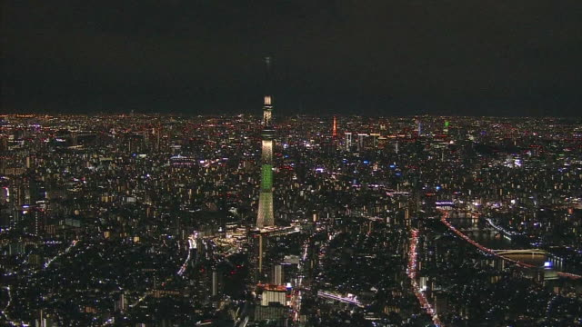 aerial, tokyo skyline in the evening - back lit stock-videos und b-roll-filmmaterial