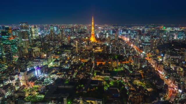 tokyo skyline traffic and tokyo tower at night - roppongi stock videos and b-roll footage