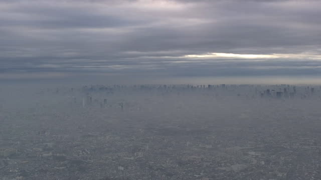 aerial, tokyo skyline veiled in morning haze, japan - fantasy stock videos & royalty-free footage