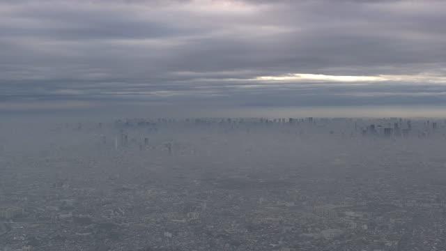 aerial, tokyo skyline veiled in morning haze, japan - fantasy stock videos and b-roll footage