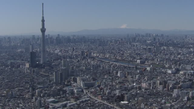 aerial, tokyo skyline with mt fuji, japan - naturwunder stock-videos und b-roll-filmmaterial