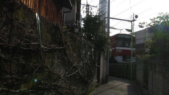 tokyo skytree towering nearby old houses alongside of railway lines including tobu skytree line - shitamachi stock videos and b-roll footage