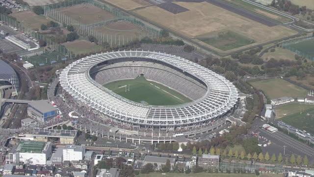 aerial, tokyo stadium, japan - オリンピックスタジアム点の映像素材/bロール