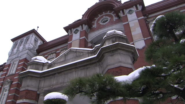 tokyo station with snow pile - kanto region stock videos & royalty-free footage
