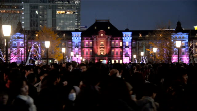 JR Tokyo Station's familiar redbrick Marunouchi building and its surroundings appeared in hues of lilac fuchsia and other colors to welcome visitors...