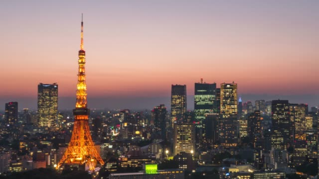 tokyo tower at dusk - tokyo tower stock videos and b-roll footage