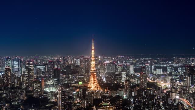tokyo tower bei nachtzeitraffer - fortschritt stock-videos und b-roll-filmmaterial