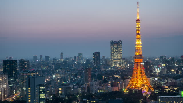 tokyo tower day to night timelapse - tokyo japan stock videos and b-roll footage