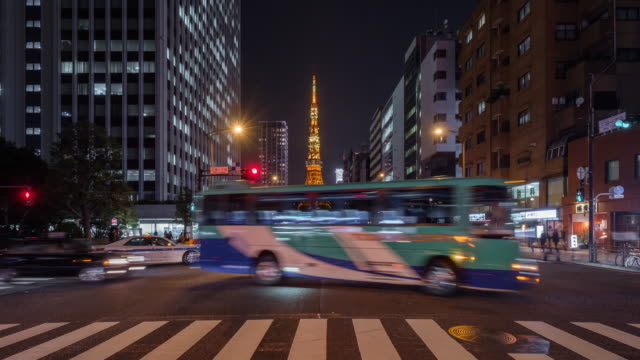 tokyo tower iconic landmark of japan with tokyo transportation in evening car light - tokyo tower stock videos and b-roll footage