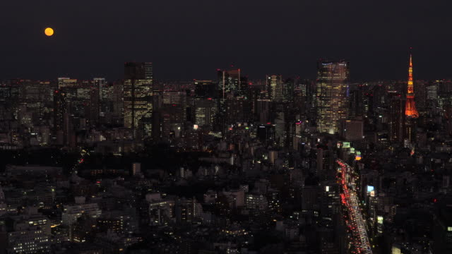 tokyo tower skyline at night | moon | zoom out - time stock videos & royalty-free footage