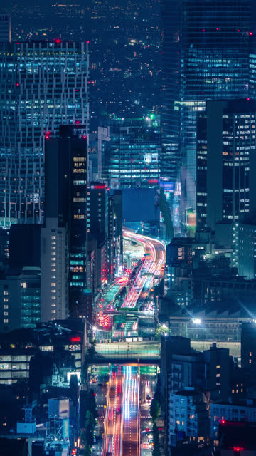 tokyo traffic and cityscape time lapse in vertical taken from roppongi hills mori tower - roppongi hills stock videos and b-roll footage