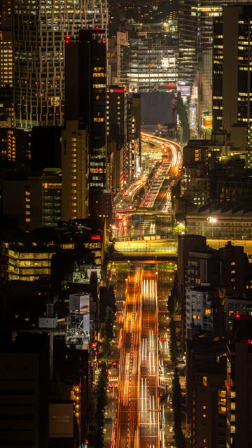 v tokyo traffic and cityscape time lapse in vertical taken from roppongi hills mori tower - roppongi hills stock videos and b-roll footage