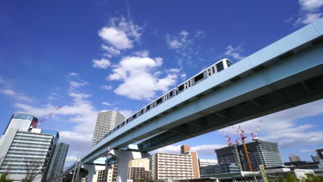 Tokyo Waterfront New Transit Yurikamome Line run on elevated railroad at Toyosu, Koto, Tokyo, Japan.