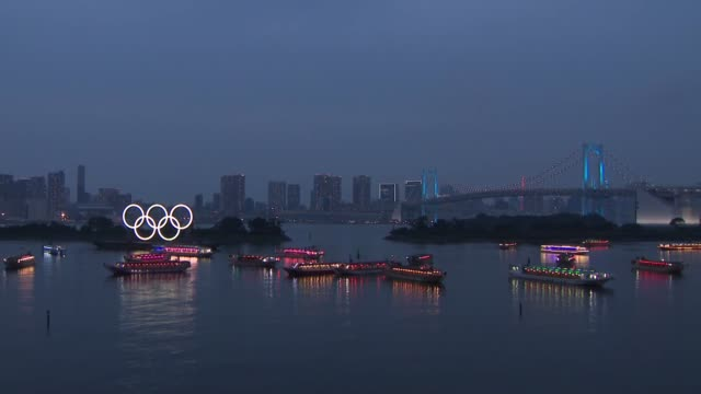 tokyo's odaiba marine park is lit up by the olympic rings and about 50 boats on july 24 to thank health care workers on the front lines of the battle... - tokyo japan stock videos & royalty-free footage