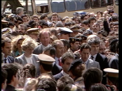 spain toledo tms minibus driven by king juan carlos of spain lr along crowded street charles and diana seated in back tms carlos amp charles amongst... - souvenir stock videos and b-roll footage