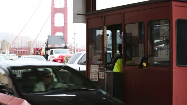Toll collectors and traffic at the Golden Gate Bridge toll plaza Workers are making last minute changes to the Golden Gate Bridge toll plaza in...