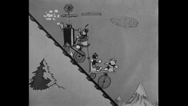 tom and jerry enjoy a precarious ride to the top of a snowy mountain range - engine stock videos & royalty-free footage