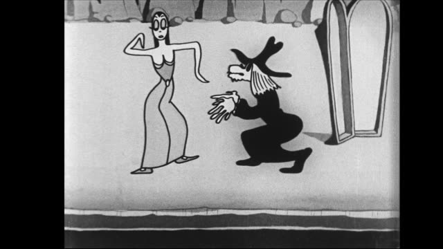Tom and Jerry watch seriously as mean witch man sings with woman