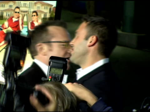 tom arnold and ben affleck at the 'the kid and i' los angeles premiere at grauman's chinese theatre in hollywood, california on november 28, 2005. - tom arnold stock videos & royalty-free footage
