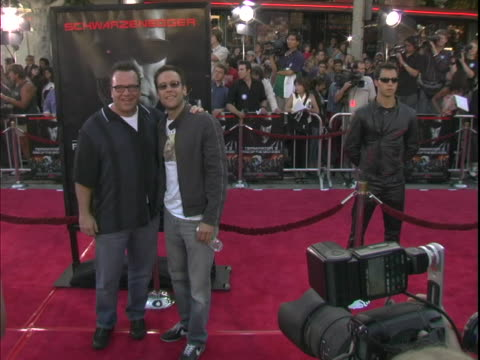 tom arnold and michael rosenbaum at the world premiere of terminator 3 : rise of the machines arrivals at manns village theater, westwood in... - terminator 3: rise of the machines stock videos & royalty-free footage