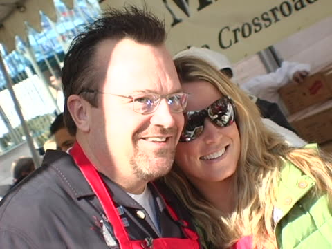 Tom Arnold and wife Shelby serving food at the 2004 Thanksgiving Meal For The Homeless at Los Angeles Mission in Los Angeles California