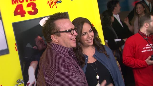 tom arnold, ashley groussman at movie 43 los angeles premiere 1/23/2013 in hollywood, ca. - tom arnold stock videos & royalty-free footage