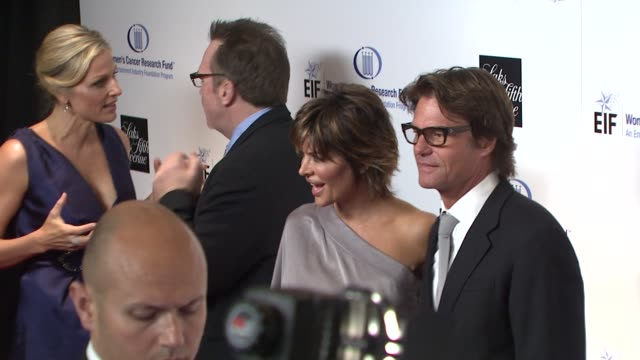 Tom Arnold Lisa Rinna Harry Hamlin at the Saks Fifth Avenue's 'An Unforgettable Evening' at Los Angeles CA