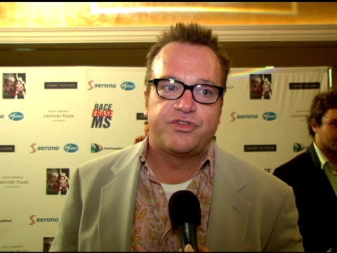 tom arnold on hosting the auction with brooke burns, his involvement with nancy and the event for many years, disco dancing, his clothes at the 13th... - 12 13 years stock videos & royalty-free footage