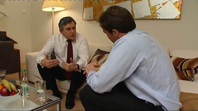 tom bradby interviews with gordon brown; england: birmingham: int reporter, tom bradby and gordon brown mp looking out of hotel window then both sit... - sofa stock videos & royalty-free footage