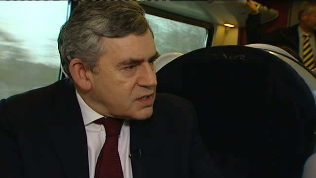 tom bradby interviews with gordon brown; int train gordon brown, on train en-route to birmingham, being wired up for interview then sitting next to... - motion stock videos & royalty-free footage