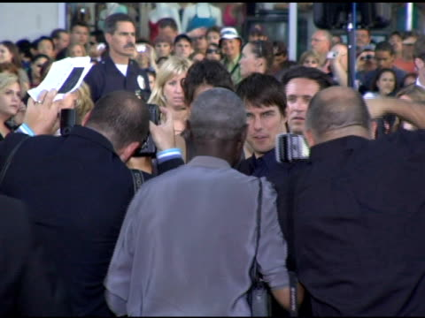 tom cruise and katie holmes at the batman begins premiere at grauman's chinese theatre in hollywood california on june 6 2005 - katie holmes stock videos and b-roll footage