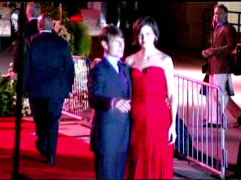 tom cruise and katie holmes pose for photos on the red carpet outside the beckham's welcome to la party - tom cruise stock videos & royalty-free footage