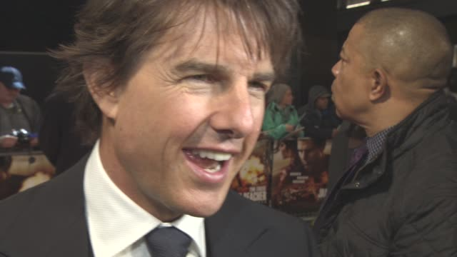 INTERVIEW Tom Cruise looking for a good story loving what he does passing out Cobie Smulders character having better fight scenes getting bruises on...