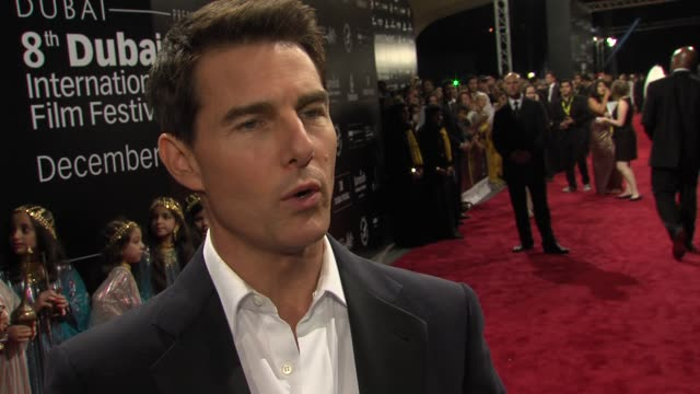 tom cruise on brad bird making films the series the film locations dubai and more at the mission impossible ghost protocol world premiere at dubai on... - トム・クルーズ点の映像素材/bロール