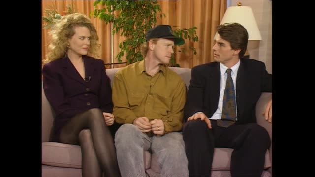Tom Cruise seated with Nicole Kidman and Ron Howard speaking about working on a film with his wife in 1992 during promotional interview with host...