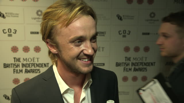 tom felton on the atmosphere at the event the importance of the british film industry at british independent film awards winners interviews at old... - tom felton stock videos & royalty-free footage