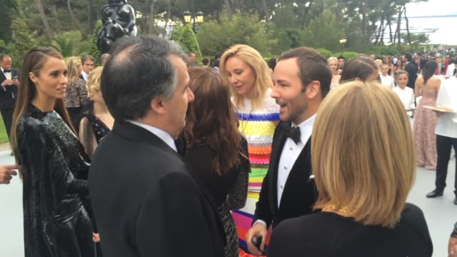 Tom Ford Johnathan Klein Roxanne Motamedi at amfAR 22nd Cinema Against AIDS Reception at Hotel du CapEdenRoc on May 21 2015 in Cap d'Antibes France