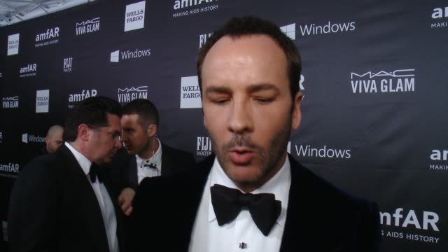vídeos de stock, filmes e b-roll de interview tom ford on how it feels to be receiving this honor how he got involved with amfar and talks about the countdown to the cure initiative at... - tom ford