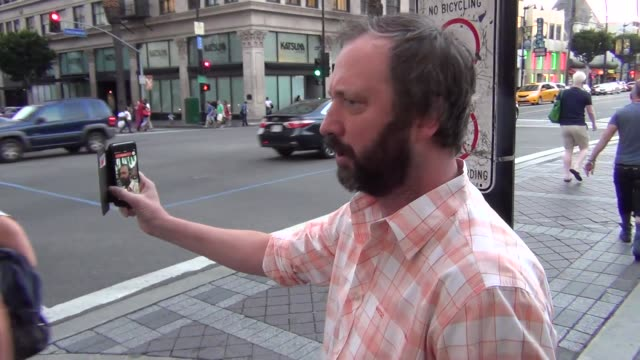 tom green on periscope with his fans in hollywood at celebrity sightings in los angeles on april 29, 2016 in los angeles, california. - トム グリーン点の映像素材/bロール