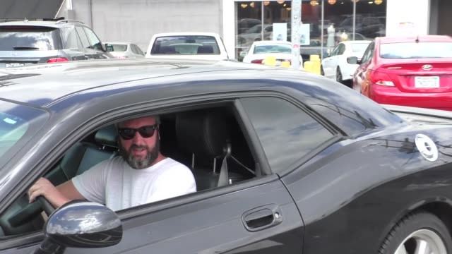 vídeos de stock, filmes e b-roll de interview tom green talks about doing standup comedy again while shopping at cvs in studio city in celebrity sightings in los angeles - tom green