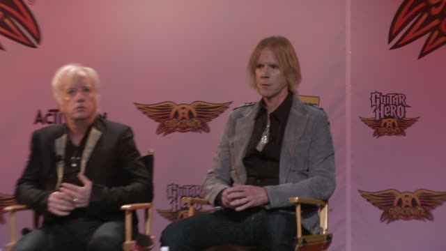 tom hamilton talks about the idea behind aerosmith guitar hero and using their music in a video game at the aerosmith launches new guitar hero at new... - エアロスミス点の映像素材/bロール