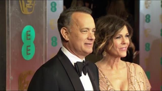 Tom Hanks and Rita Wilson pose for photographers at the BAFTAs 2014