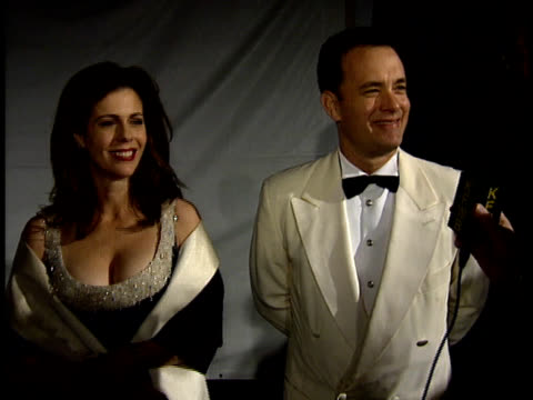 Tom Hanks and Rita Wilson speak to reporters on the red carpet