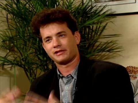 vídeos de stock e filmes b-roll de tom hanks gives an interview about his love of baseball. - tom hanks